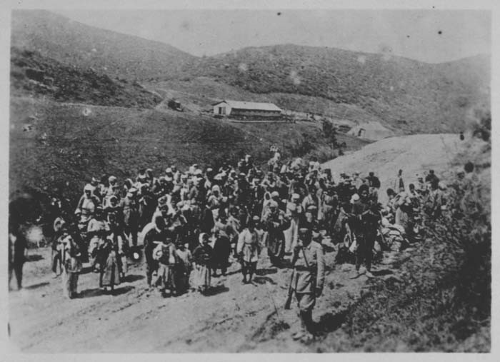 Ottoman troops guard Armenians being deported. Ottoman Empire, 1915 – 1916. National Archives and Records Administration.