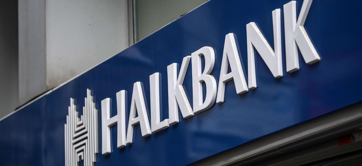 A picture taken on December 1, 2107 shows the logo of the Turkish bank Halkbank in Istanbul. A Turkish-Iranian gold trader testifying at trial in New York on November 29 implicated Turkey's President Recep Tayyip Erdogan in a multi-billion-dollar gold-for-oil scheme allegedly designed to subvert US sanctions on Iran. / AFP PHOTO / OZAN KOSE