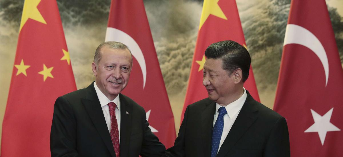 Chinese President Xi Jinping, right, and Turkish President Recep Tayyip Erdogan shake hands prior to their meeting at the Great Hall of the People in Beijing, Tuesday, July 2, 2019.(Presidential Press Service via AP