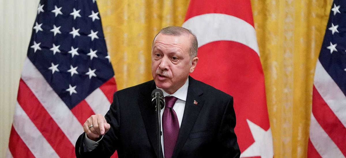 Turkey's President Tayyip Erdogan answers questions during a joint news conference with U.S. President Donald Trump at the White House in Washington, U.S., November 13, 2019.
