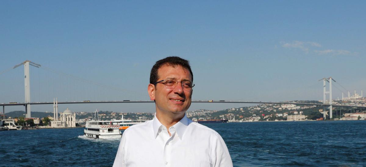 Ekrem Imamoglu, mayoral candidate of the main opposition Republican People's Party (CHP), poses with the Bosphorus bridge in the background following an election rally in Istanbul, Turkey, June 22, 2019.