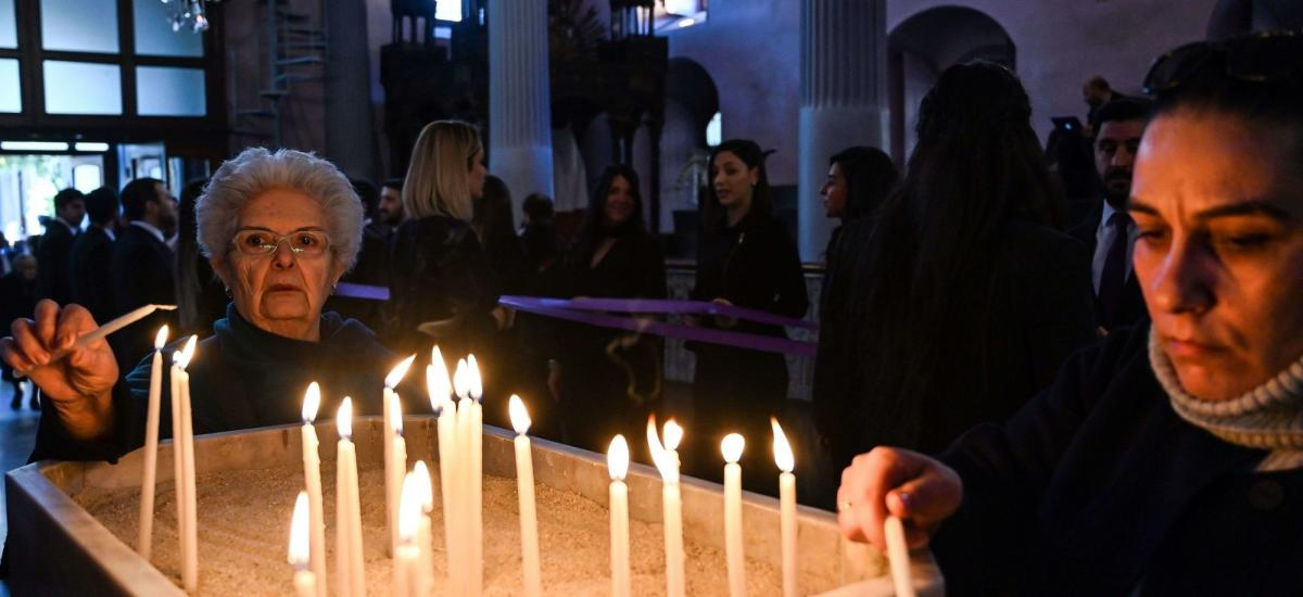 People light up candles in an Istanbul church