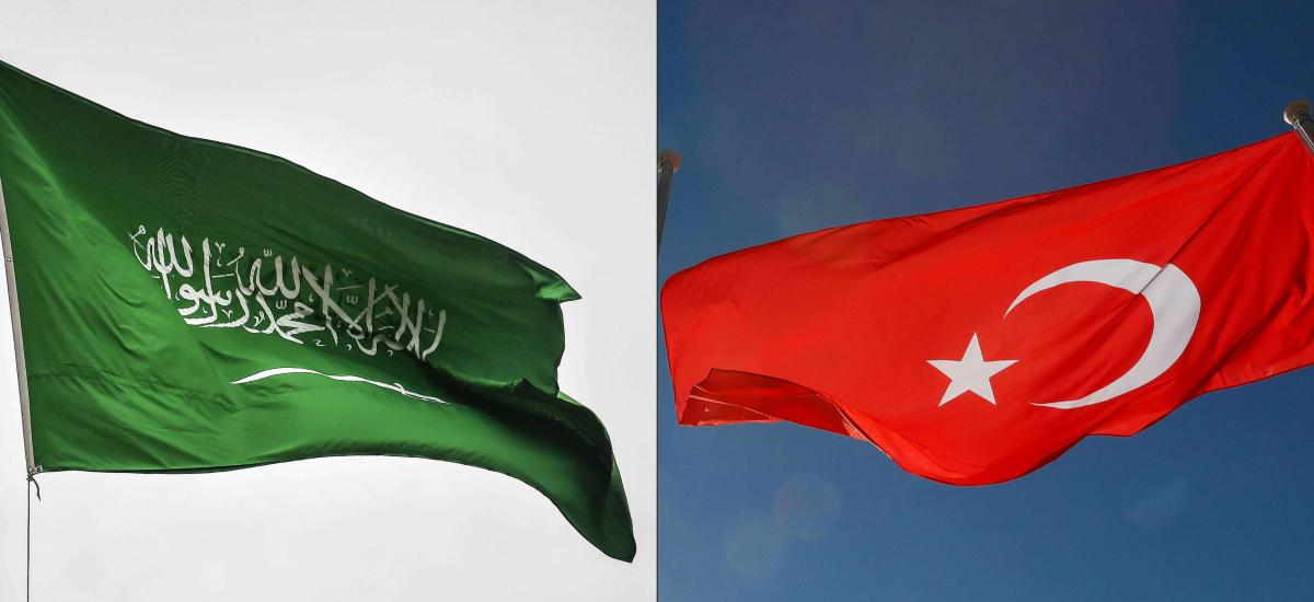This combination of pictures created on October 19, 2020 shows (L to R) a photo taken on October 17, 2018 depicting a Saudi flag flying over the consulate building in Istanbul, Turkey; and a photo taken on September 27, 2018 showing the flag of Turkey flying at Tegel airport in Berlin. (Photos by OZAN KOSE and Odd ANDERSEN / AFP)