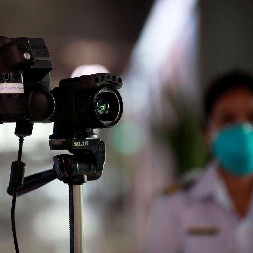 An official uses a thermal camera at the arrivals hall of Suvarnabhumi Airport as a measure to prevent the spread of coronavirus in Bangkok, Thailand January 24, 2020.